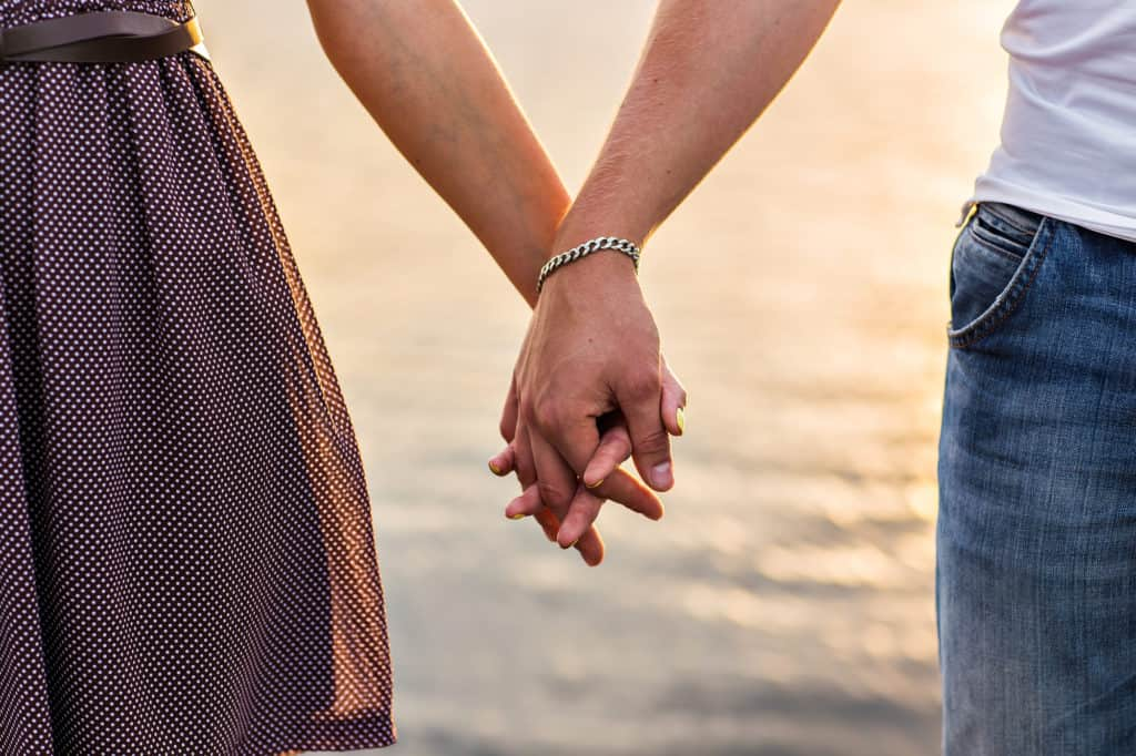 when to hold her hand